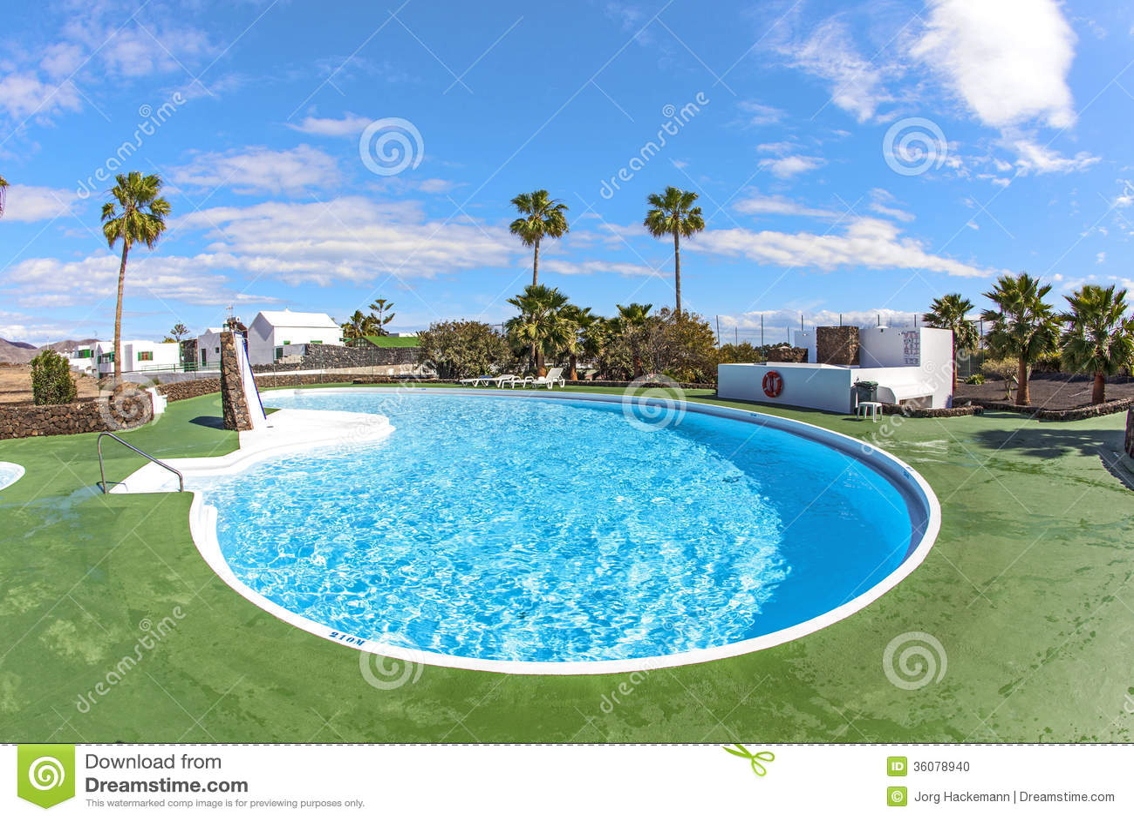 Outdoor pool in spain stock photo image 36078940 for Garden treasures pool clock