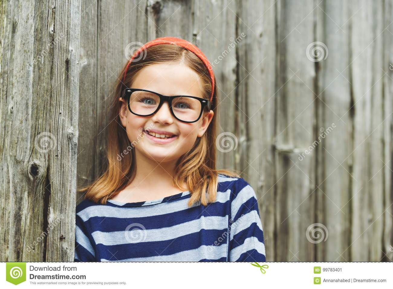 46164f4ce3 Outdoor portrait of a cute little 9 year old girl wearing eyeglasses