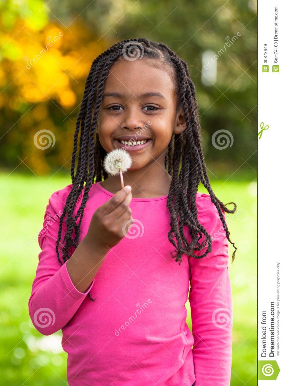 Outdoor Portrait Of A Cute Young Black Girl