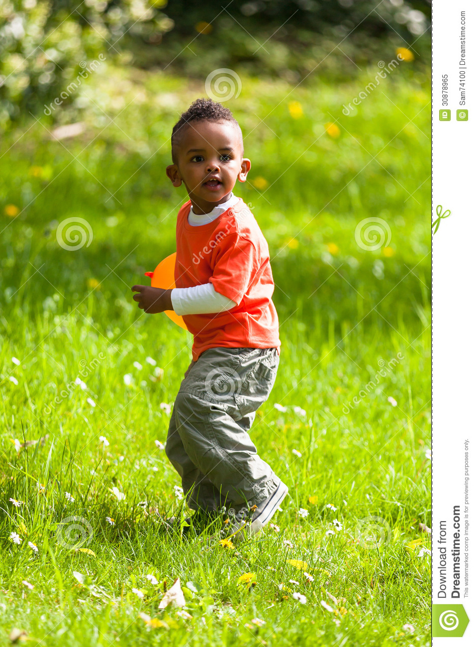 Strange Outdoor Portrait Of A Cute Young Little Black Boy Playing With Short Hairstyles Gunalazisus