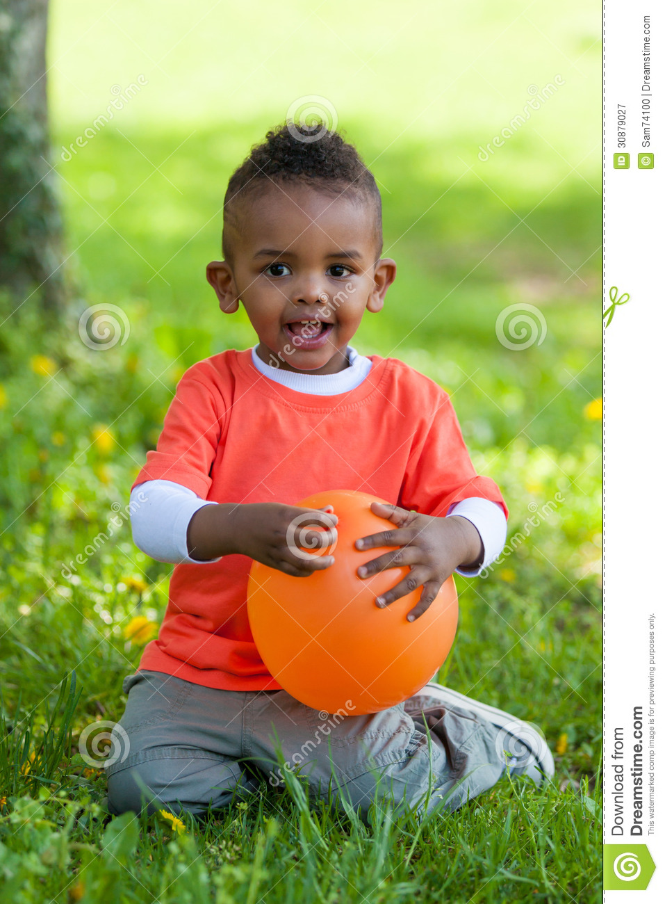 Sensational Outdoor Portrait Of A Cute Young Little Black Boy Playing With Short Hairstyles Gunalazisus