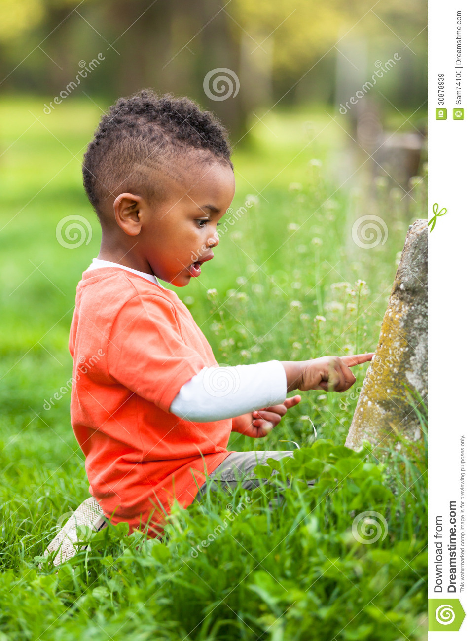 Outdoor Portrait Of A Cute Young Little Black Boy Playing