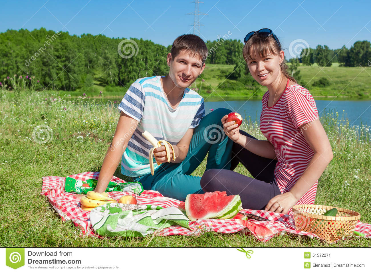 Outdoor Portrait Of Happy Loving Couple Having A Picnic At