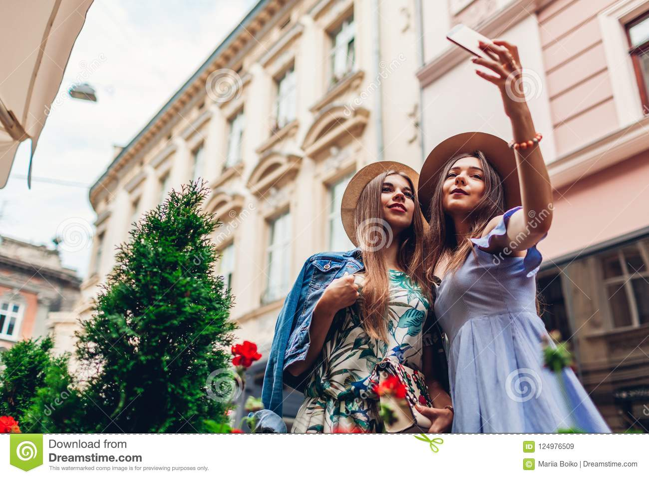 Download Outdoor Portrait Of Two Young Beautiful Women Taking Selfie Using Phone Girls Having Fun