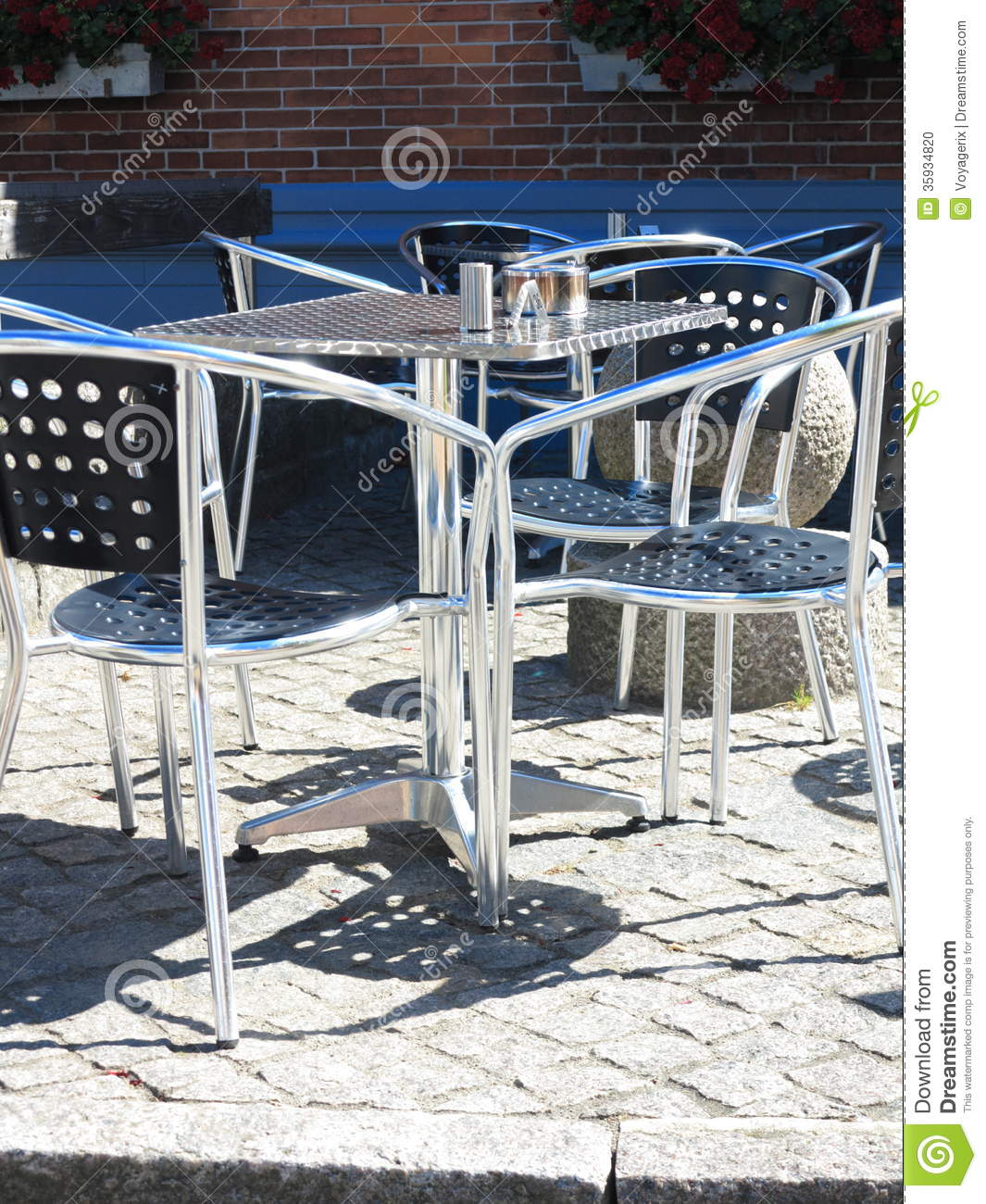 Outdoor restaurant cafe chairs with table stock photo for Terrace cafe opentable