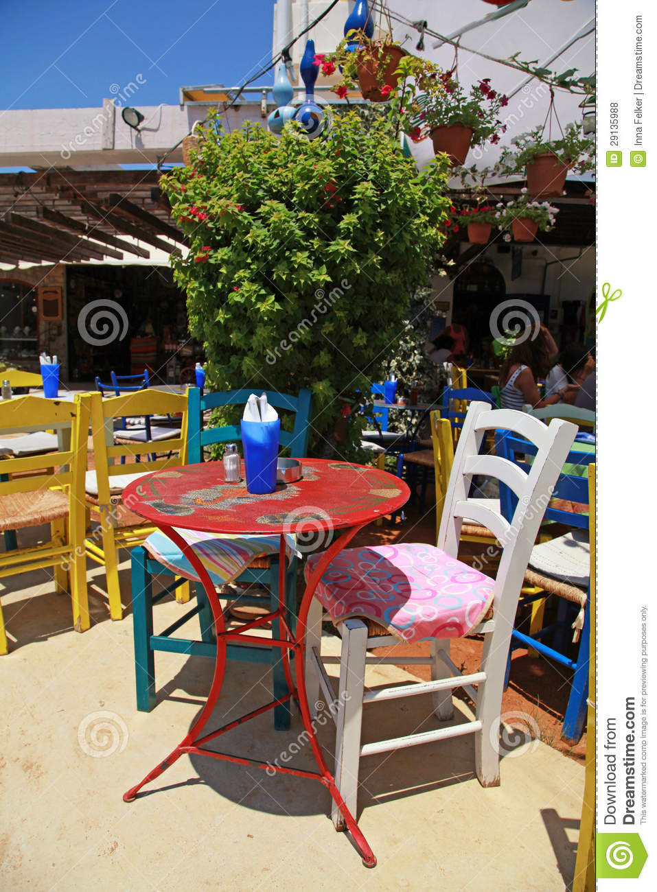 Outdoor restaurant with multicolored furniture crete