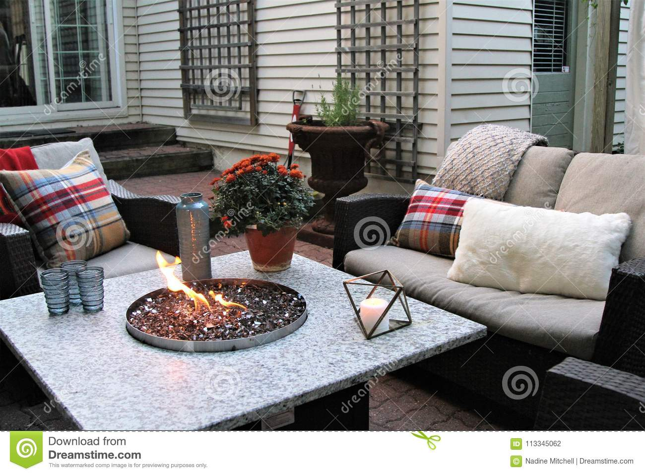 Outdoor Seating Arrangement Around A Gas Fire Pit Table In The Fall Stock Photo Image Of Plant Warm 113345062