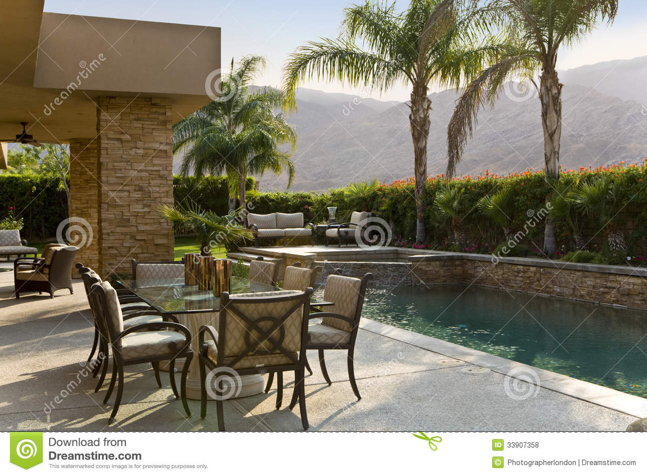 Outdoor table by swimming pool royalty free stock photos for Poolside table and chairs