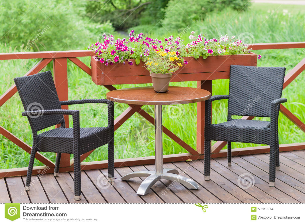 Outdoor terrace cafe table with two chairs stock photo for Terrace cafe opentable