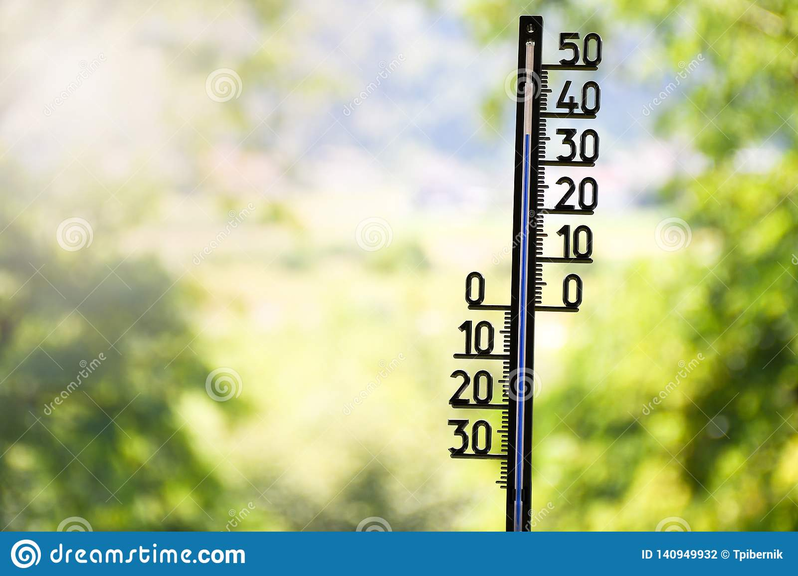 Outdoor thermometer showing 36 degrees Celsius
