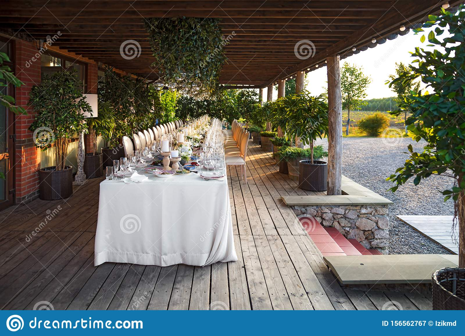 Outdoor Wedding Celebration At A Restaurant Festive Table Setting Catering Wedding In Rustic Style In Summer Stock Image Image Of Background Bouquet 156562767