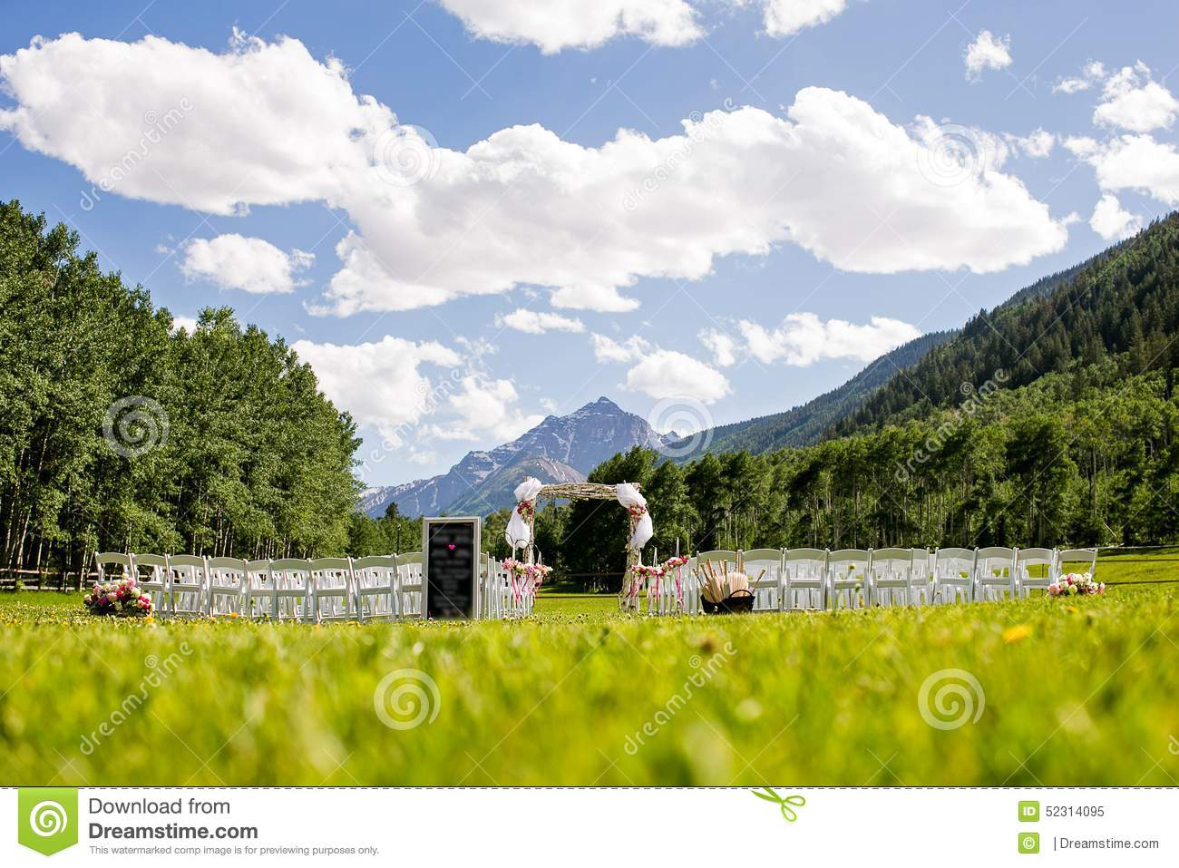 Outdoor Mountain Wedding Ceremony. Scenic Background Includes Mountain  Peak, Trees, Blue Sky And Clouds.