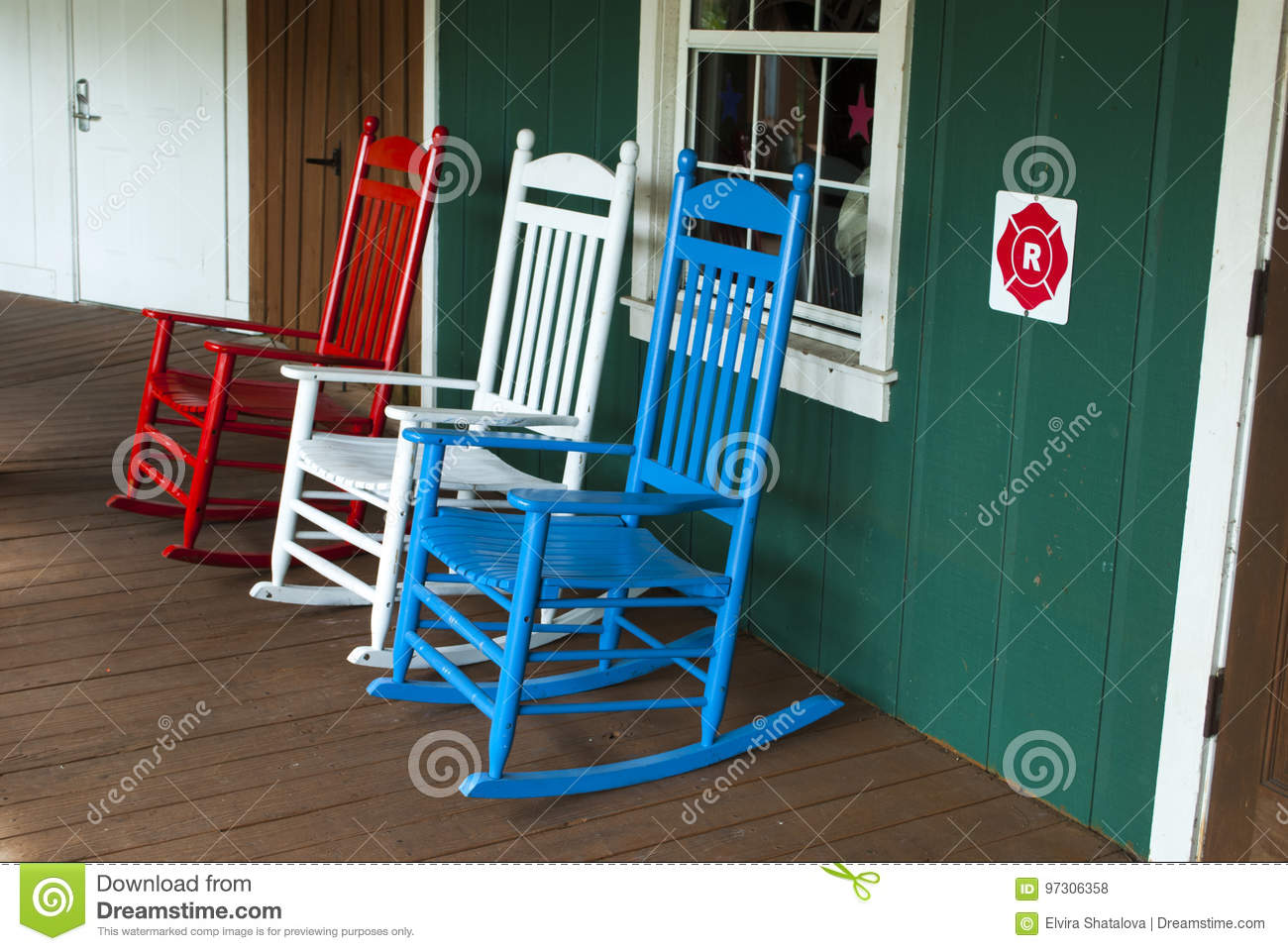 3 Outdoor Wooden Rocking Chairs In Red White And Blue Color Stock