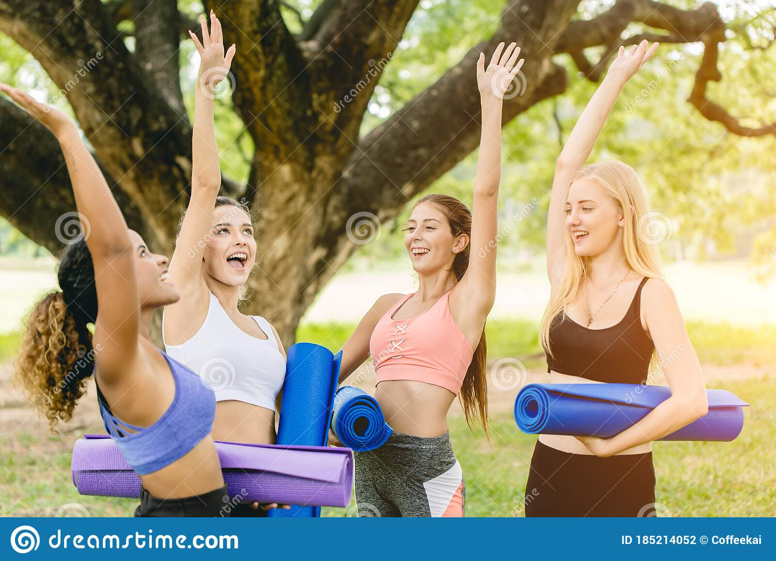 Outdoor Yoga Class, Group Of Young Healthy Women Teen