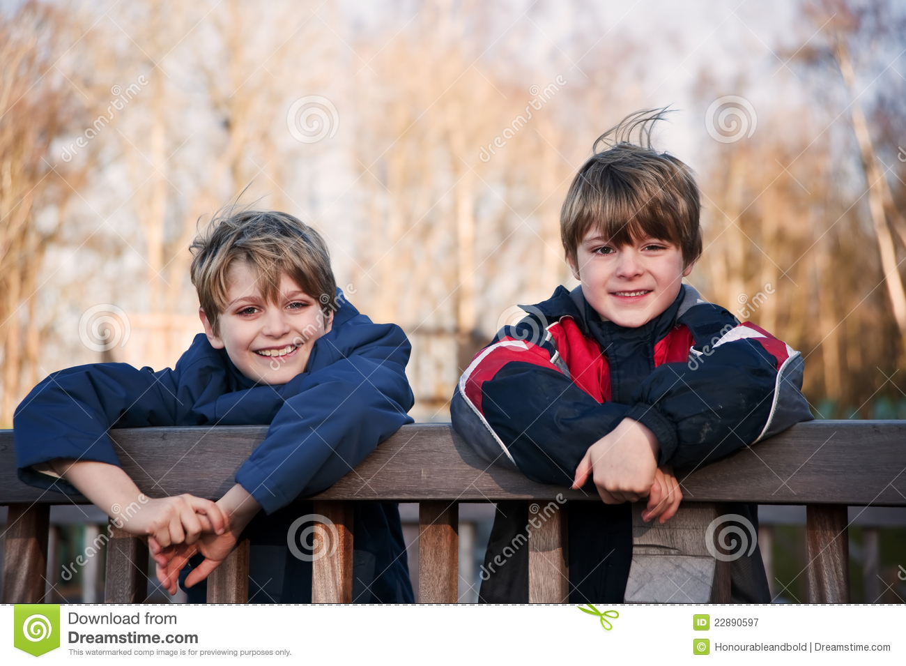 Outdoors portrait of two young happy brothers