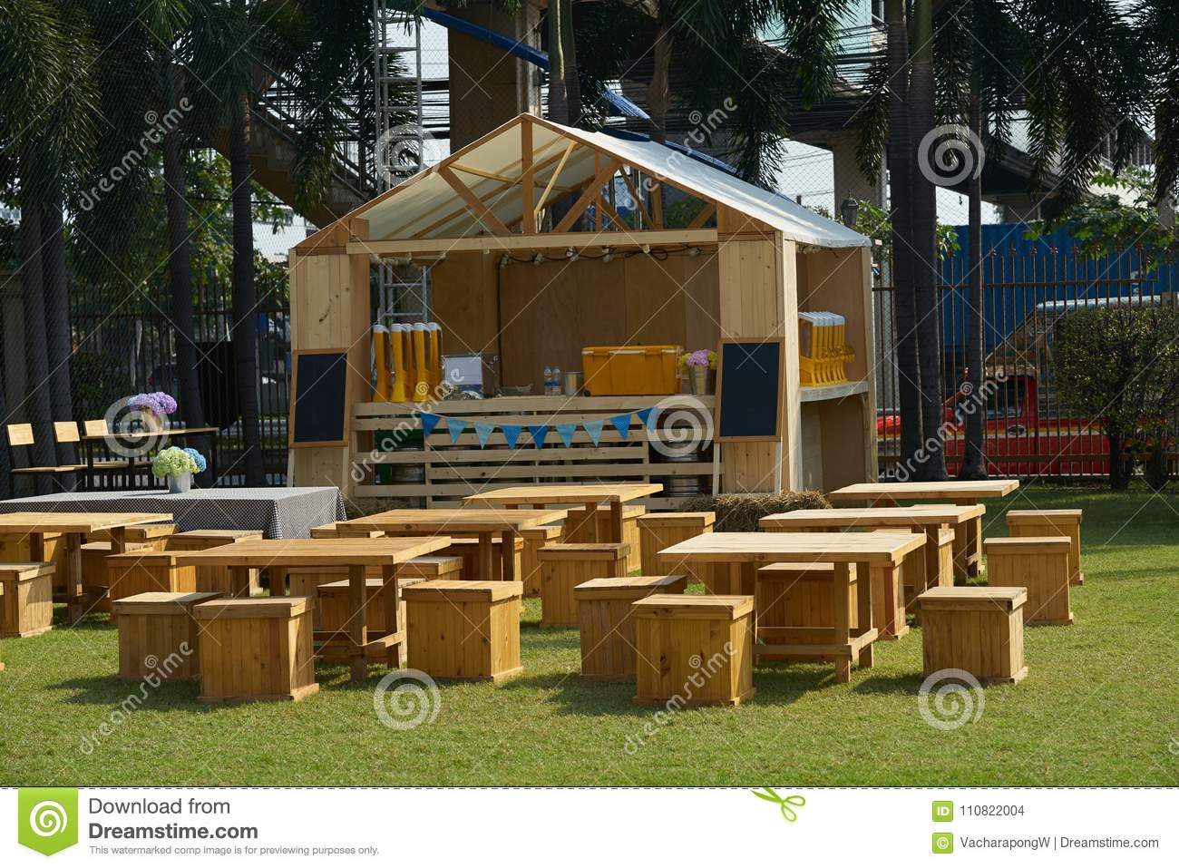 Outdoors restaurant tables and chairs and counter front in grass