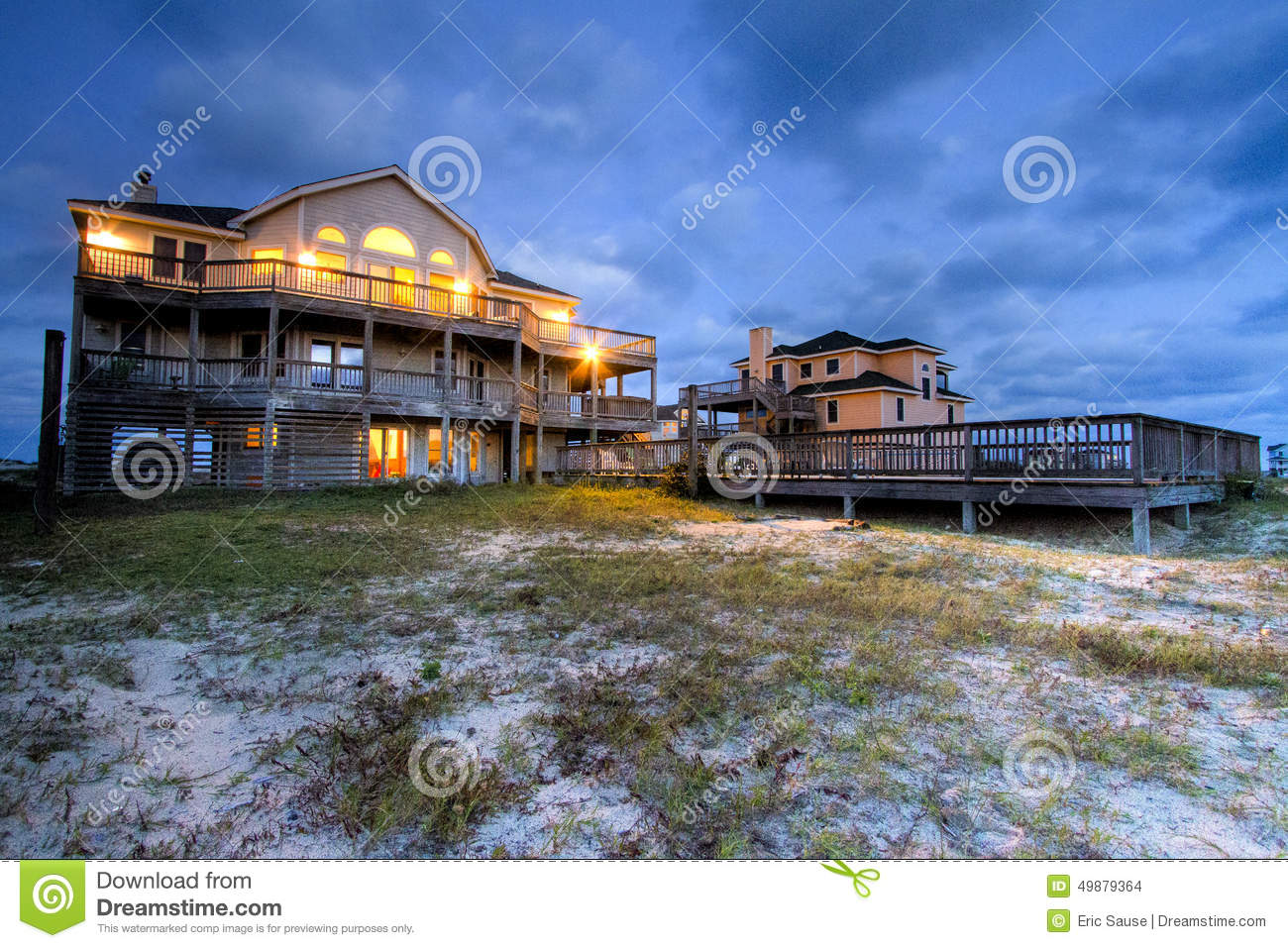 Outer banks beach house with pool at night stock photo for Beach house plans outer banks