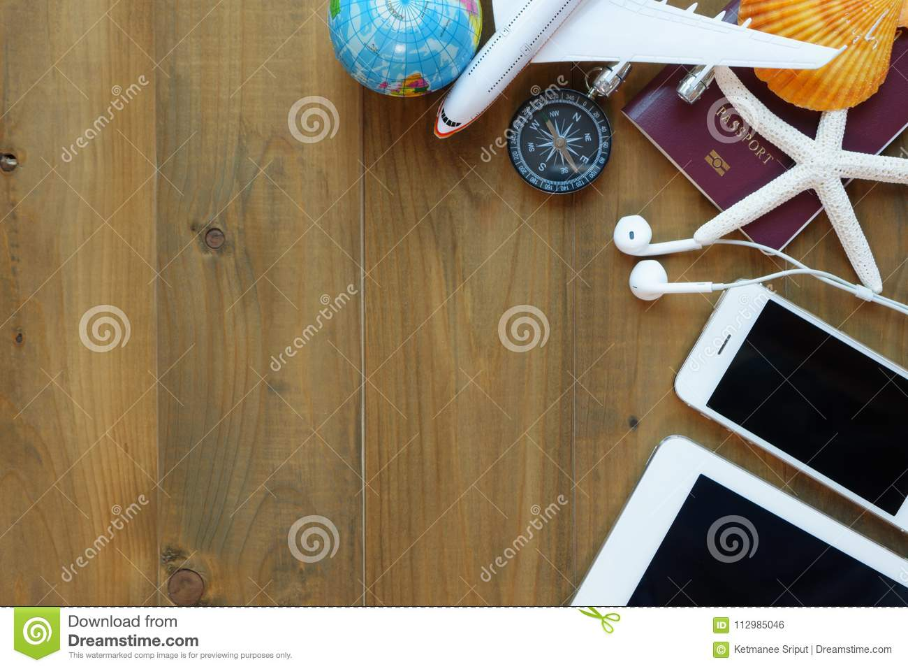 Outfit of travel on wooden background