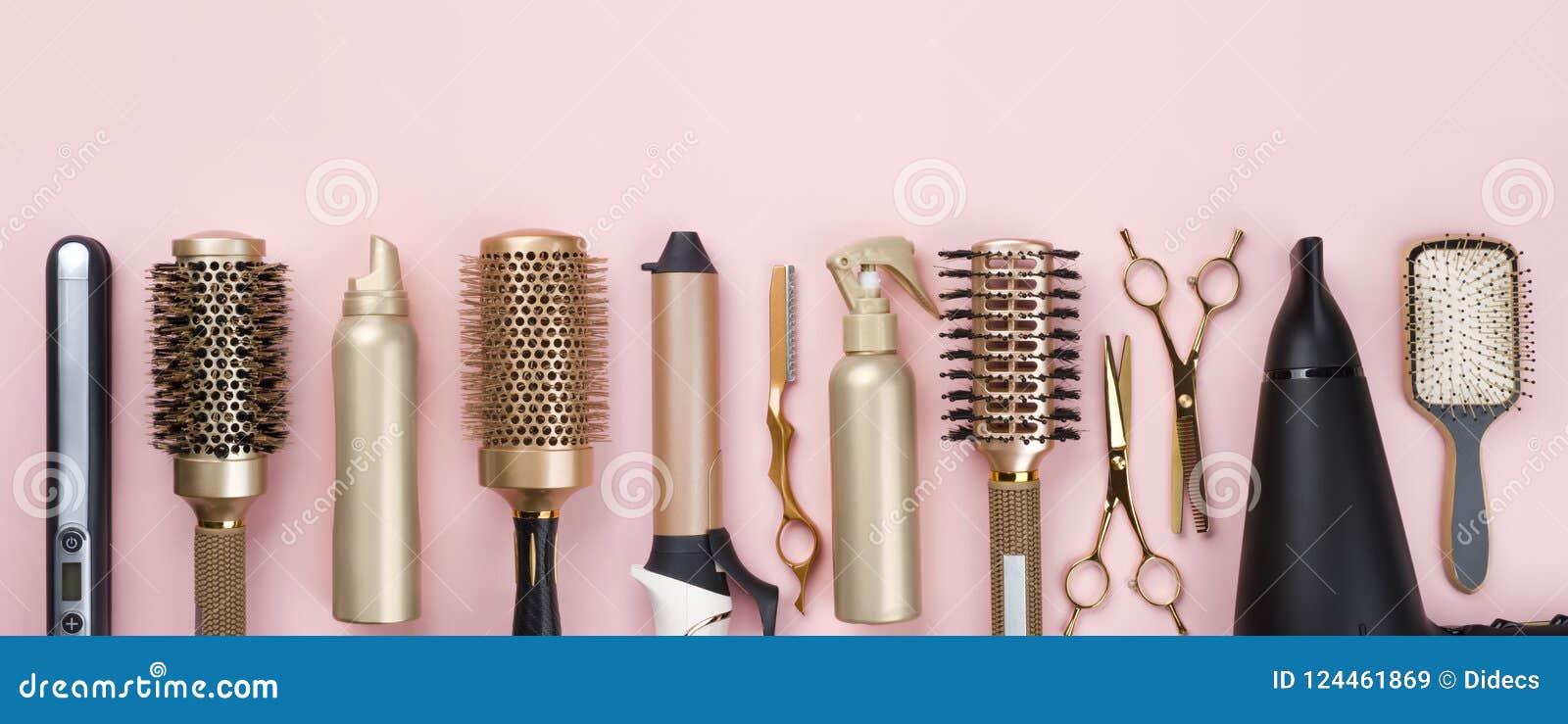 Outils professionnels de raboteuse de cheveux sur le fond rose avec l espace de copie