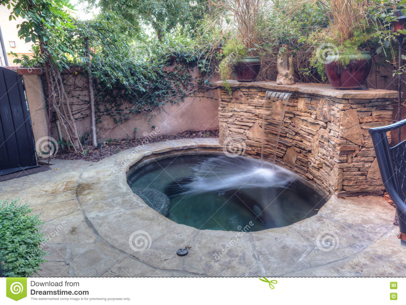 Oval Hot Tub Spa With Waterfall And Feng Shui Garden Decor