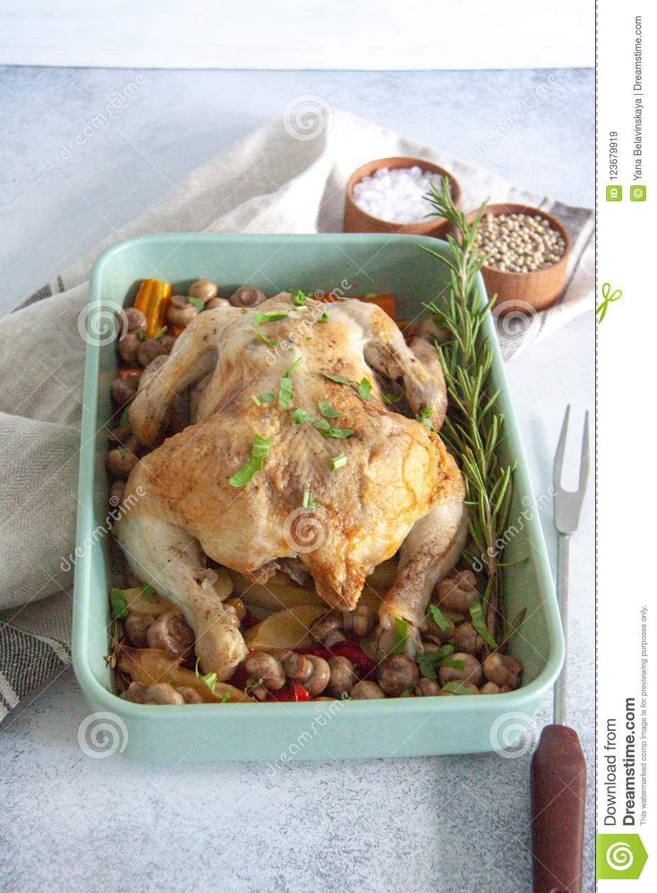Oven bakes chicken with veggies and mushrooms