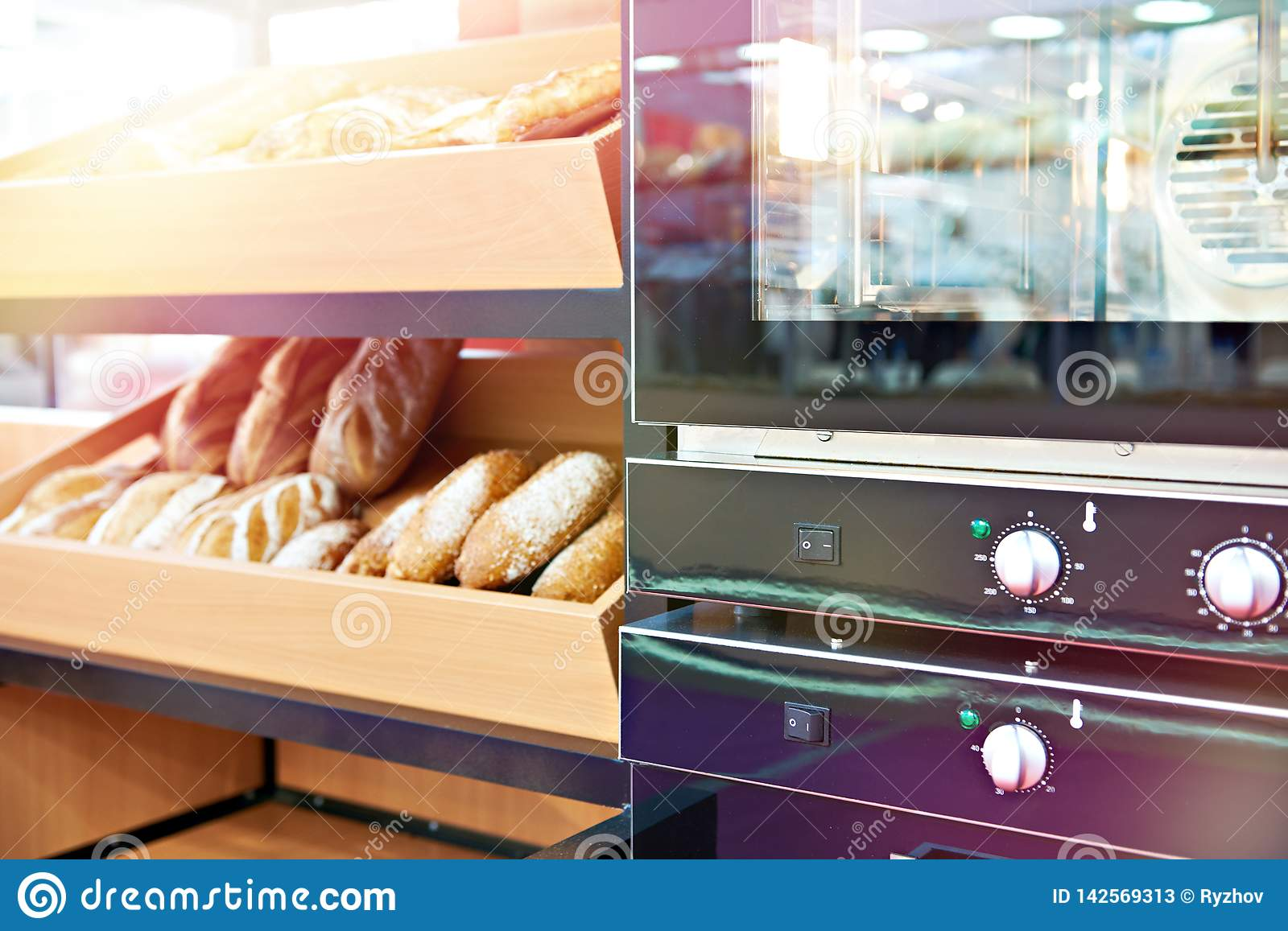 Oven and loaves of bread on shelf