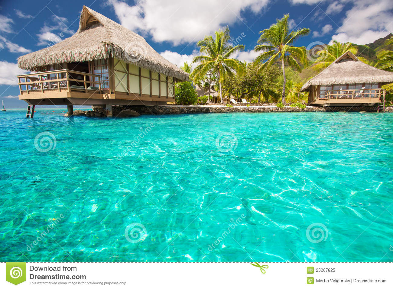 Over water bungalows with steps into blue lagoon