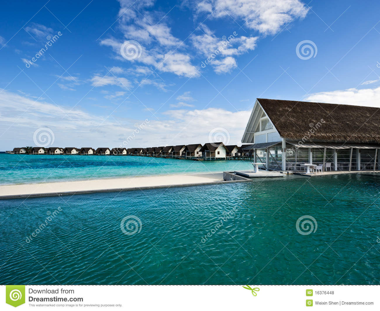 Over Water House And Swimming Pool In Beach Resort Stock