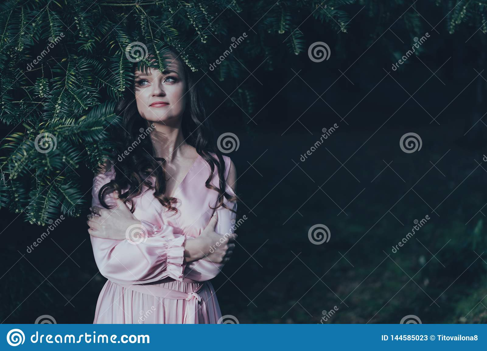 Overed woman`s face with a plant