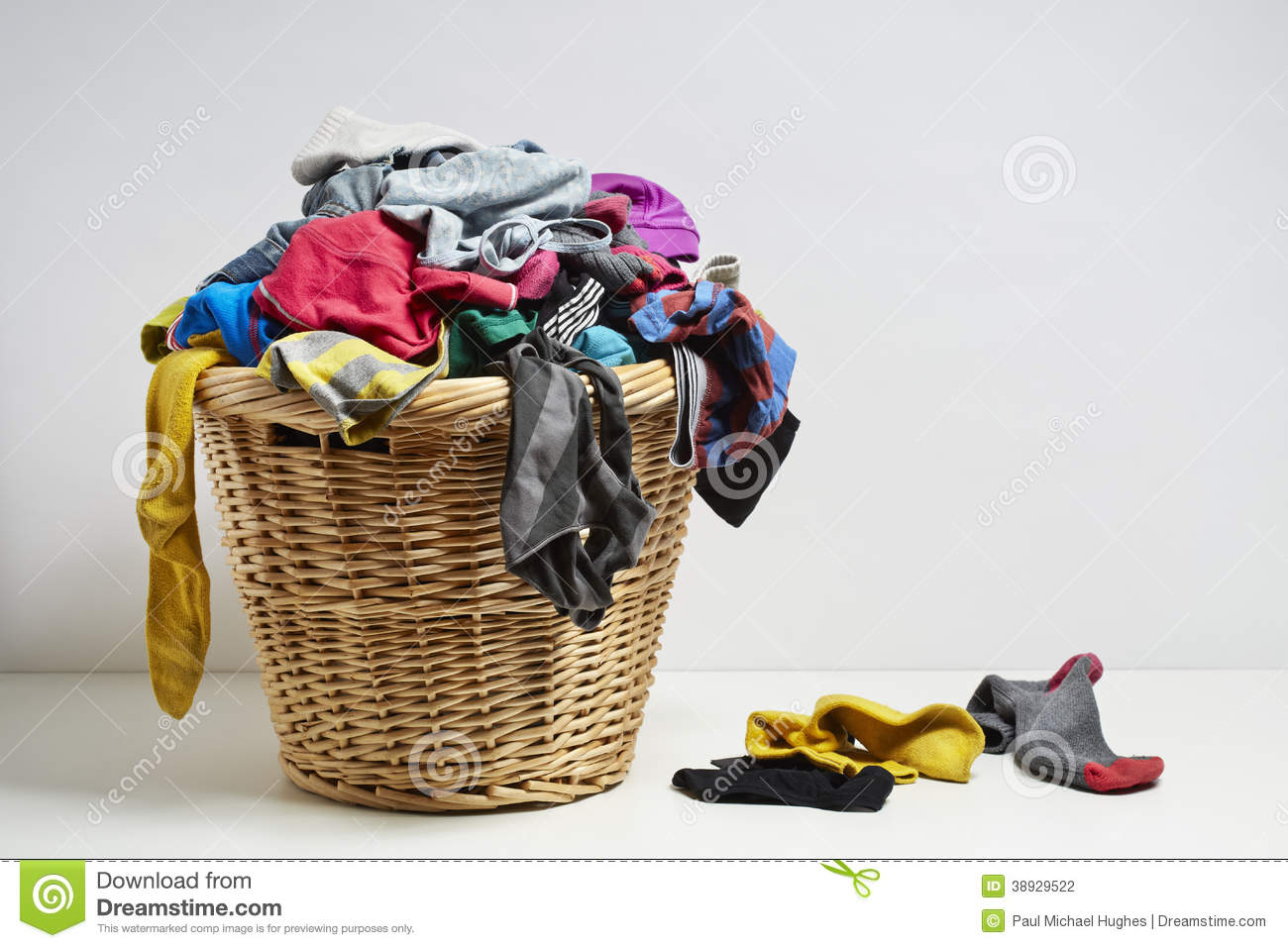 Overflowing laundry basket. Household chore concept on white ...