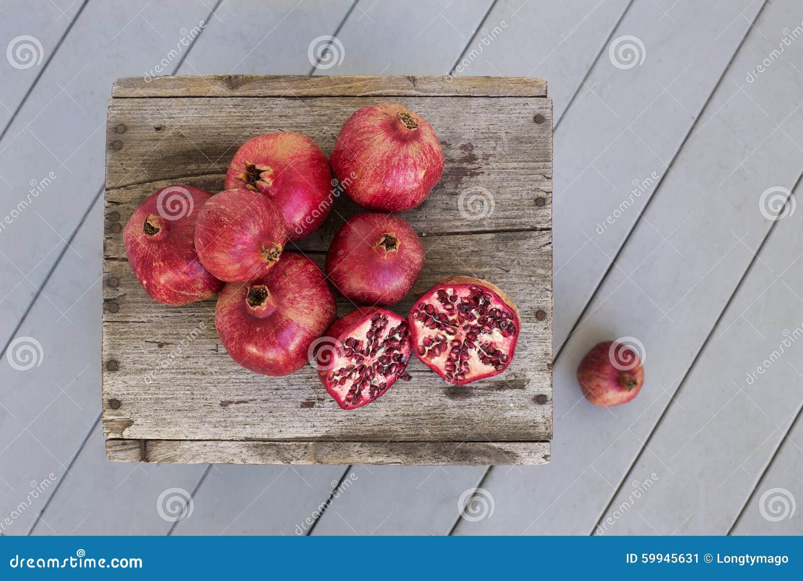 Overhead of Pomegranates on weathered wood
