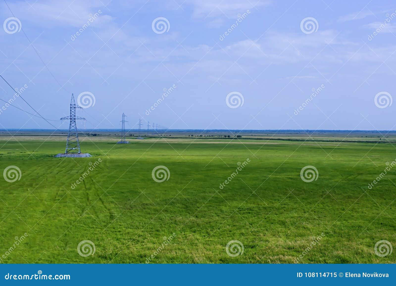 Overhead power line on the plain.