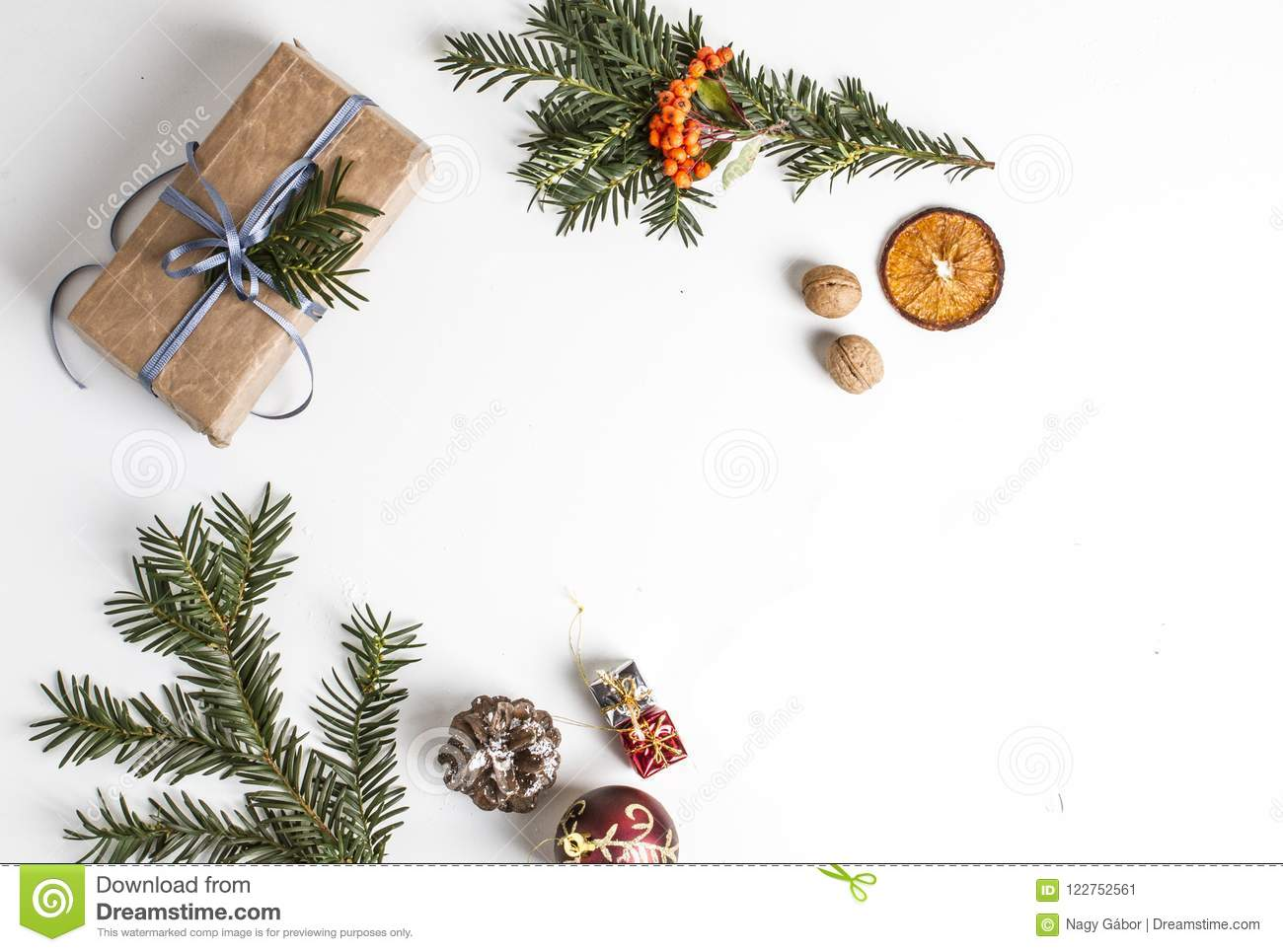 OVERHEAD RUSTIC HOMEMADE PRESENT BOX. CHRISTMAS ORNAMENTS ON WHITE BACKGROUND
