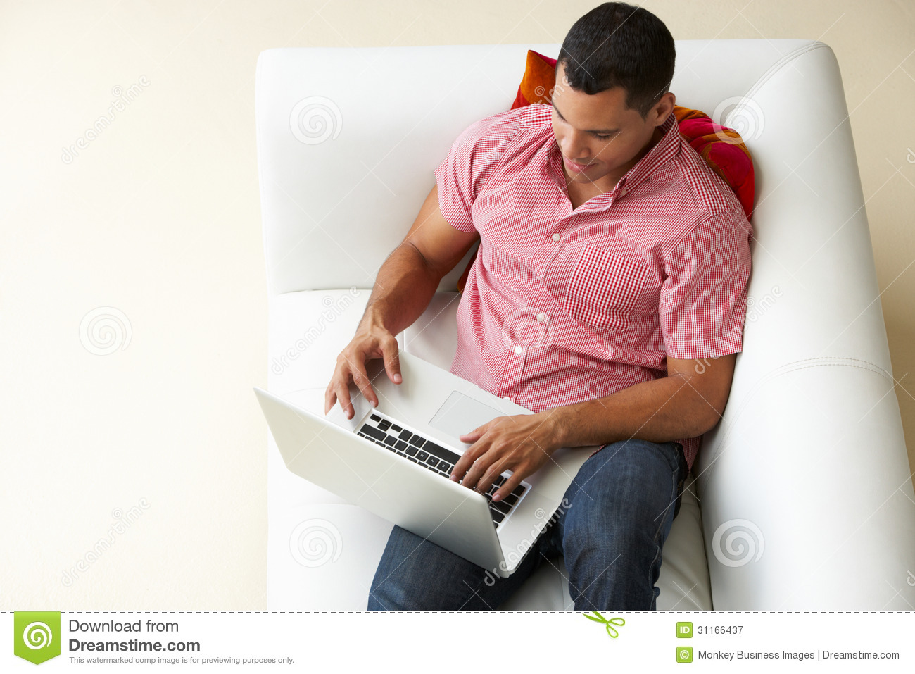 Overhead View Of Man Relaxing On Sofa Using Laptop Royalty