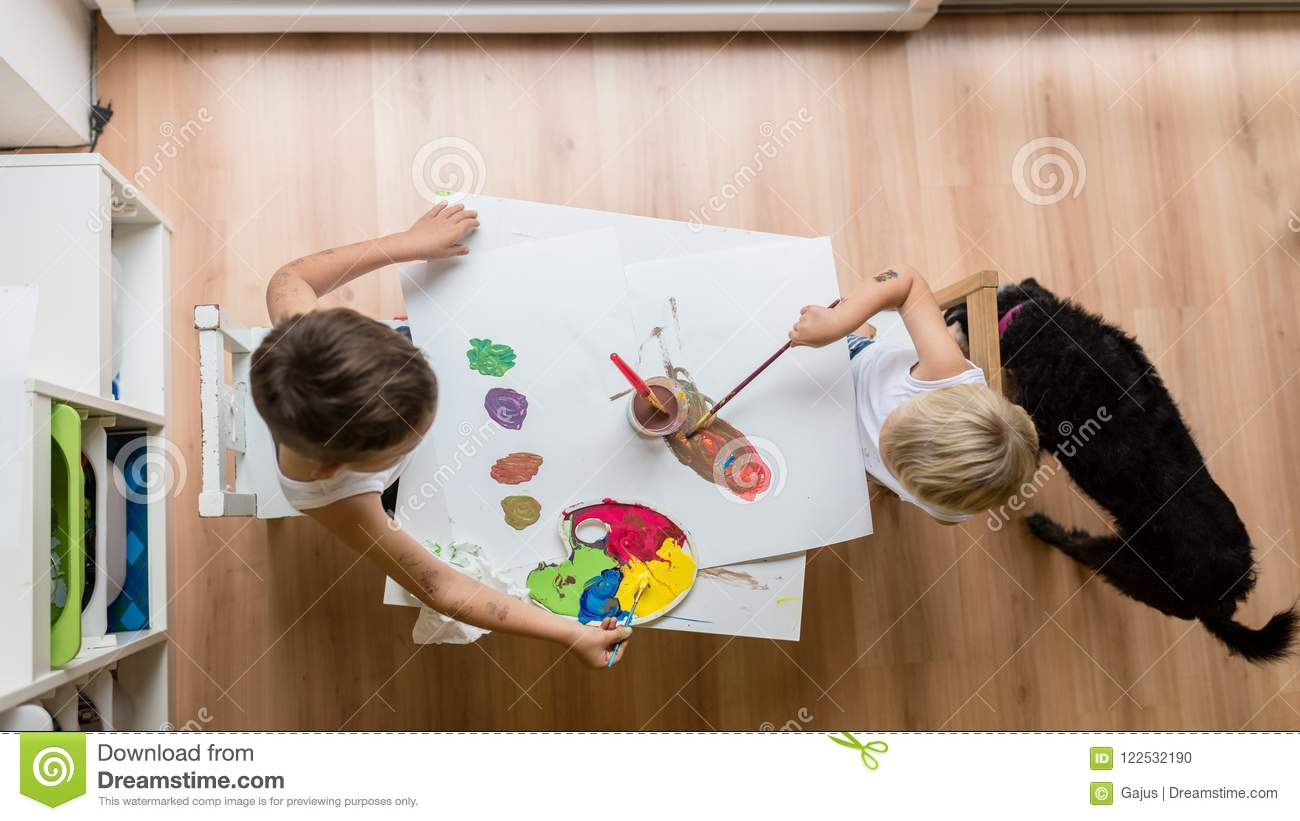 Overhead View Of Two Toddler Children Painting With Water Colour ...