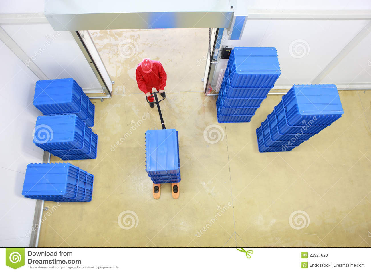 Overhead view of worker working in storehouse
