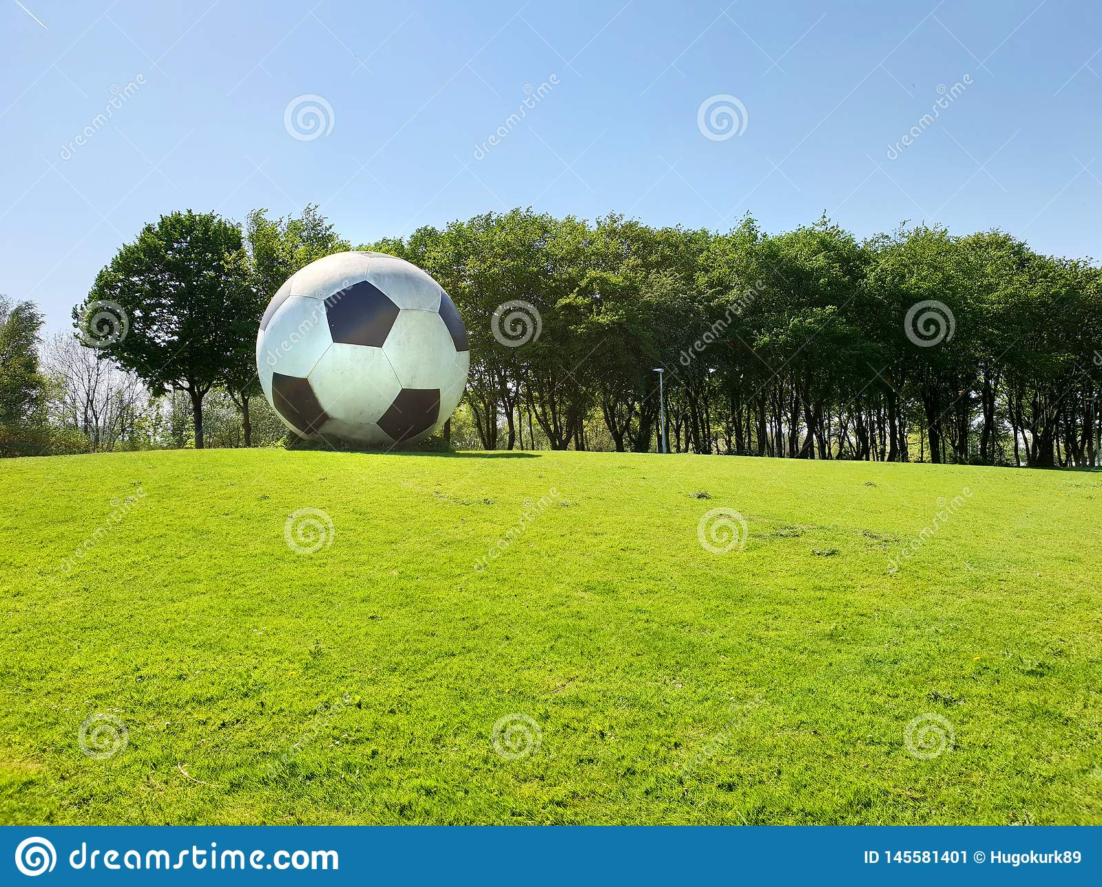 Oversized football as an artwork in public space
