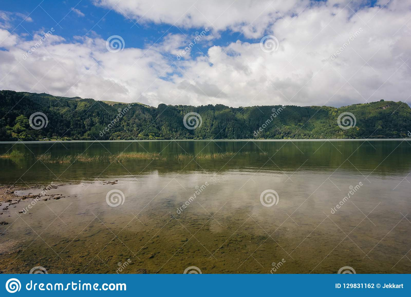 Overview lake, blue sky, clouds, trees Jose do Canto Forest Garden, Furnas, Sao Miguel, Azores Portugal