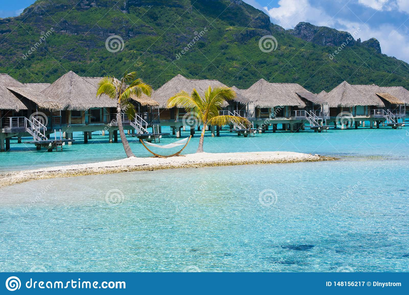 Overwater Bungalow And Hammock On Island In Bora Bora Stock