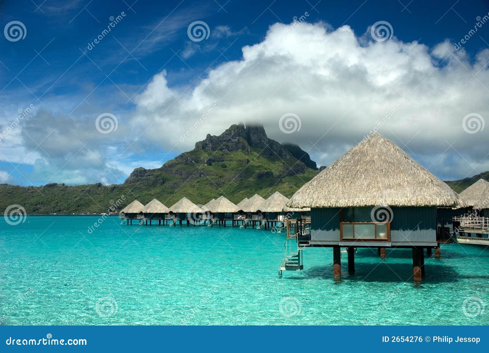 overwater bungalow at tahiti stock photo