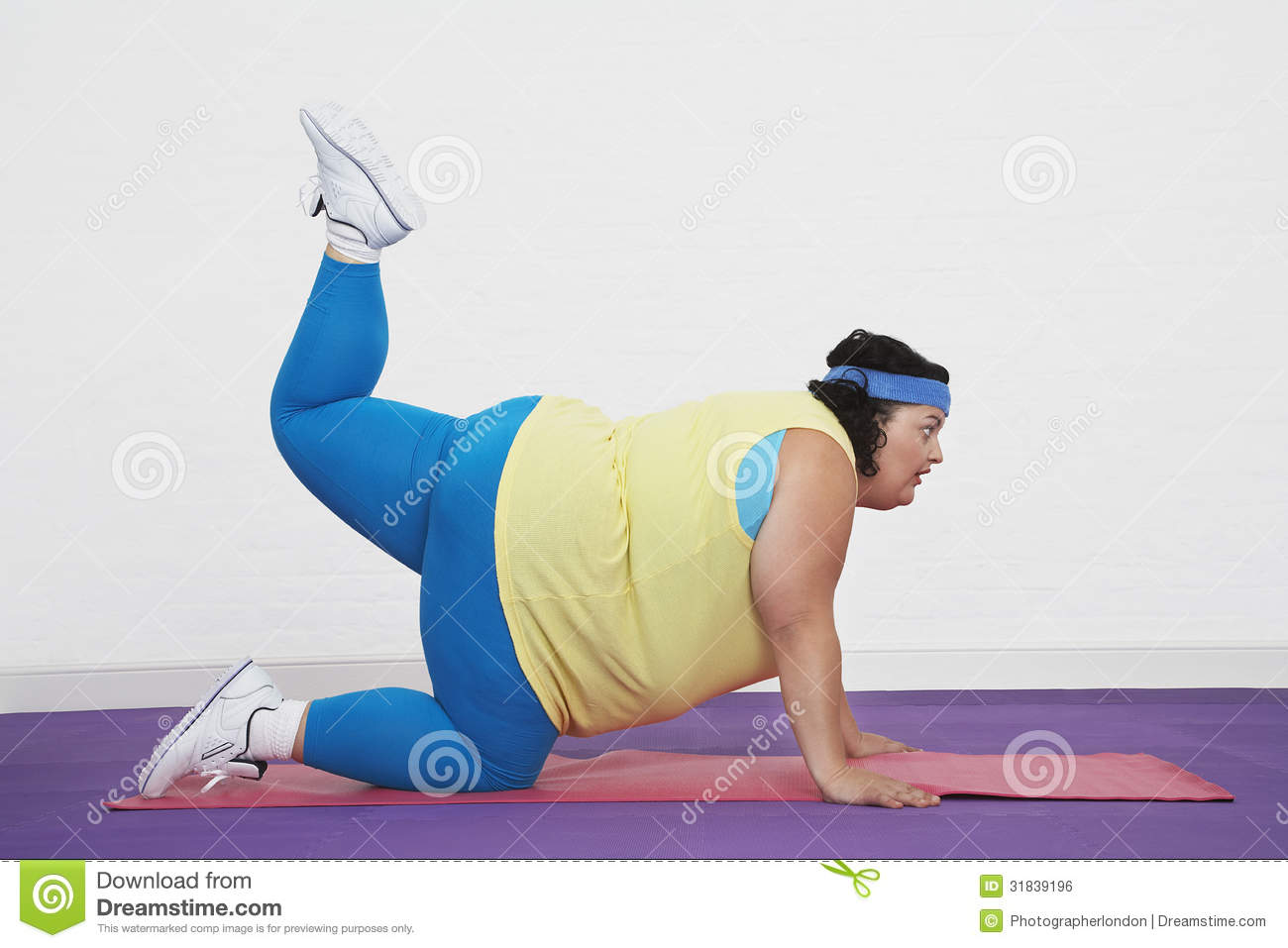Overweight Woman Doing Aerobic Stretches Stock Photo ...