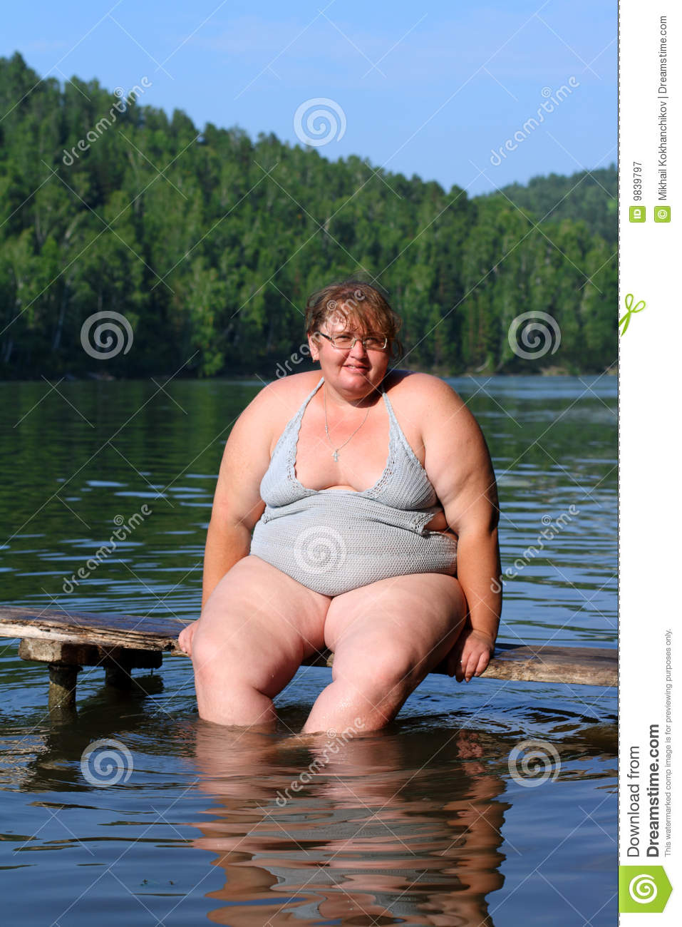 Overweight woman sitting on stage