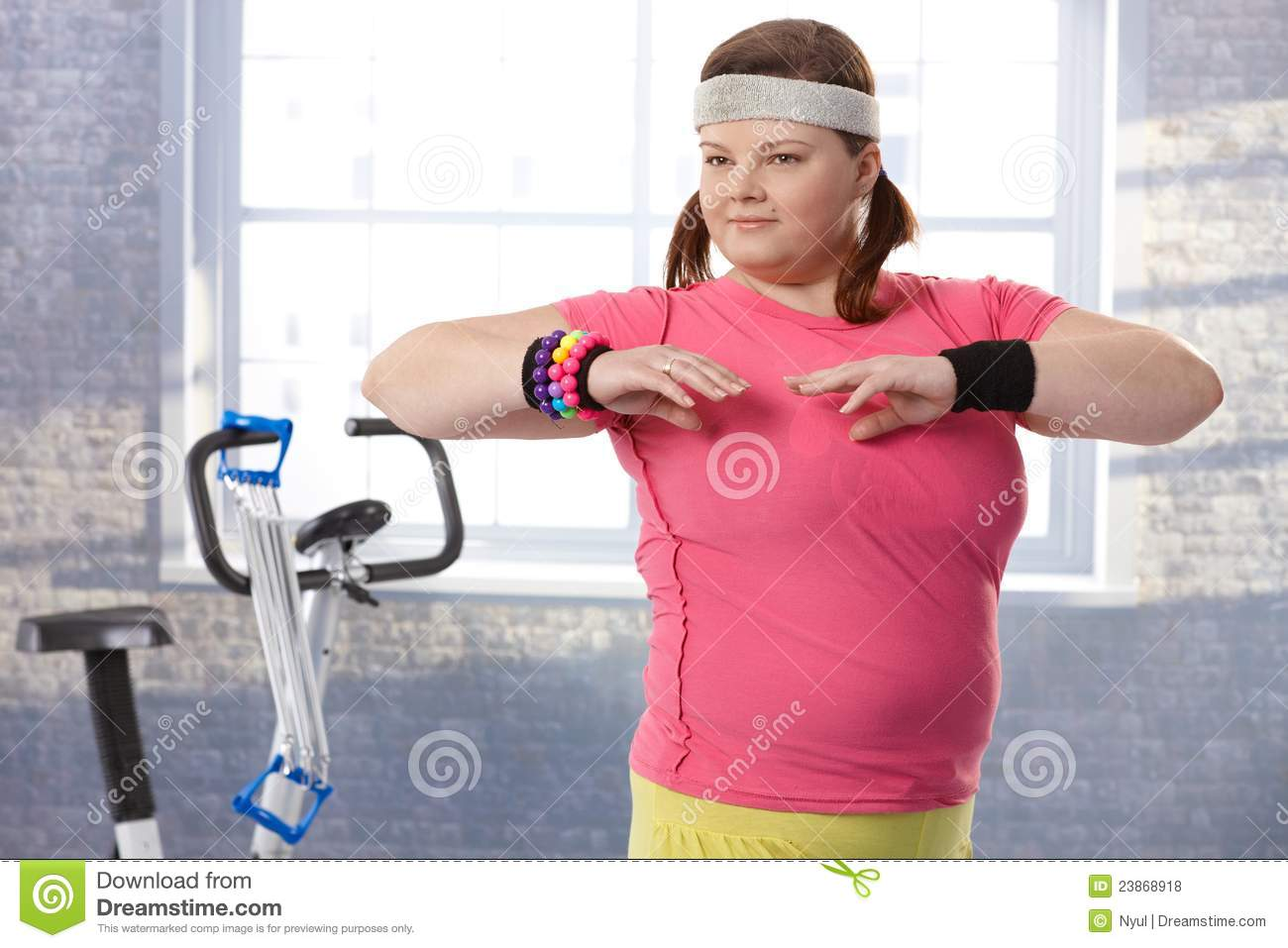 Overweight Young Woman At The Gym Royalty Free Stock