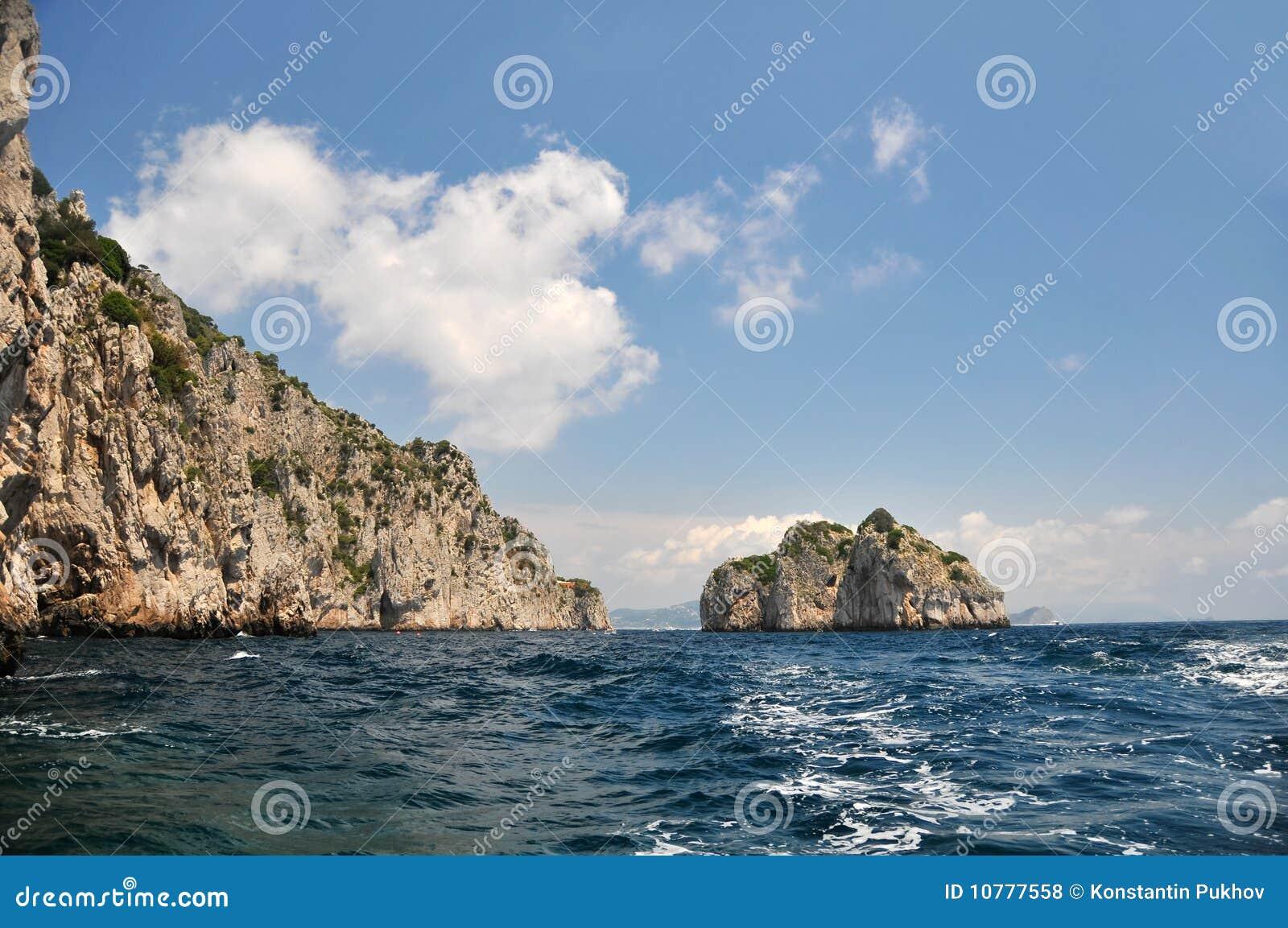 Overzees, bergen, zon