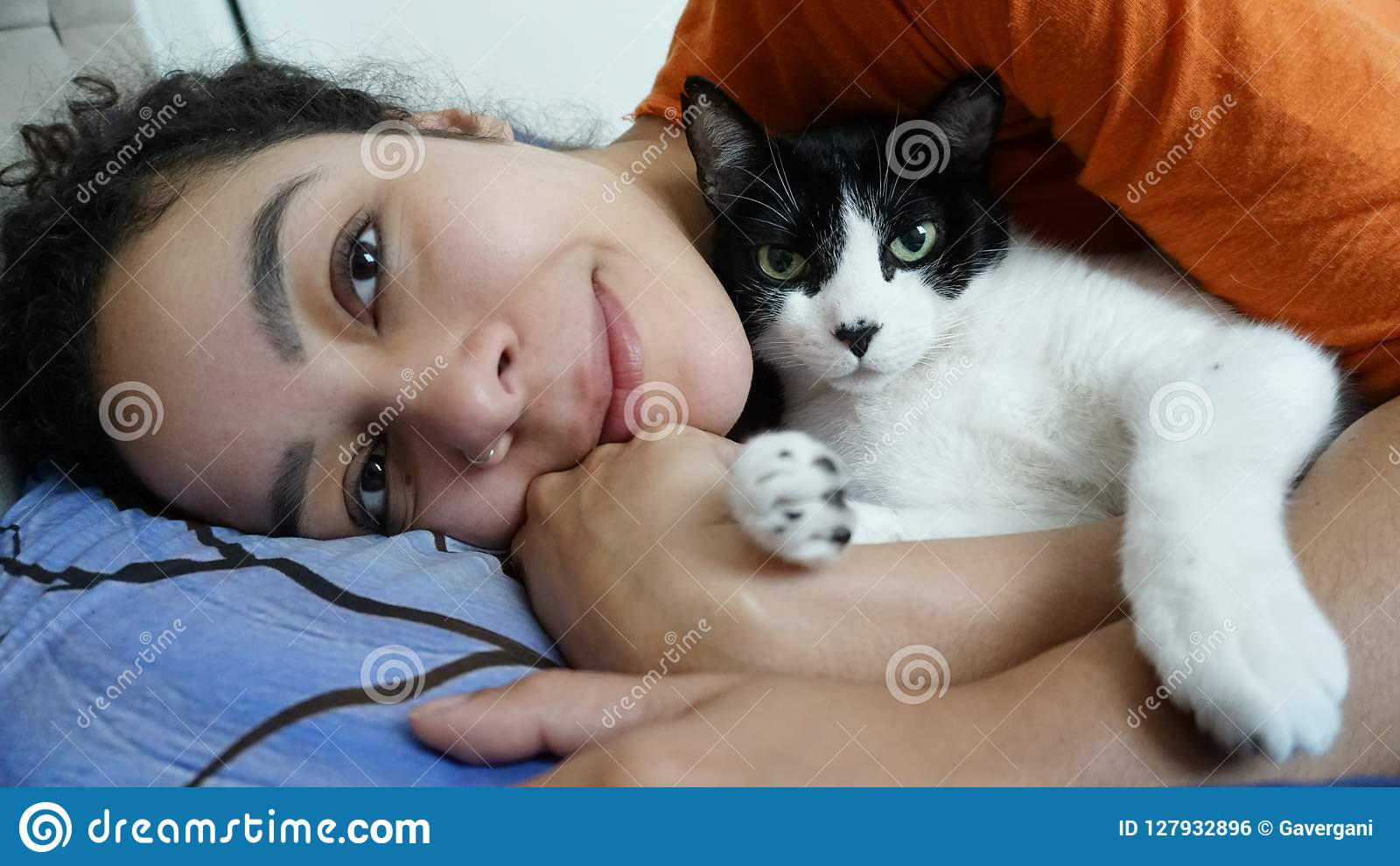 Owner and pet lie on the bed.