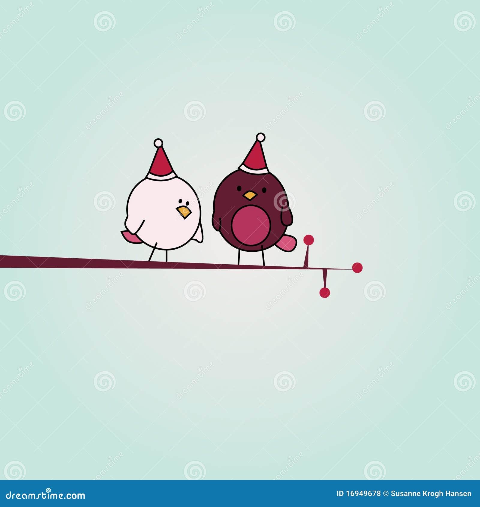 Pájaros de la Navidad en la ramificación