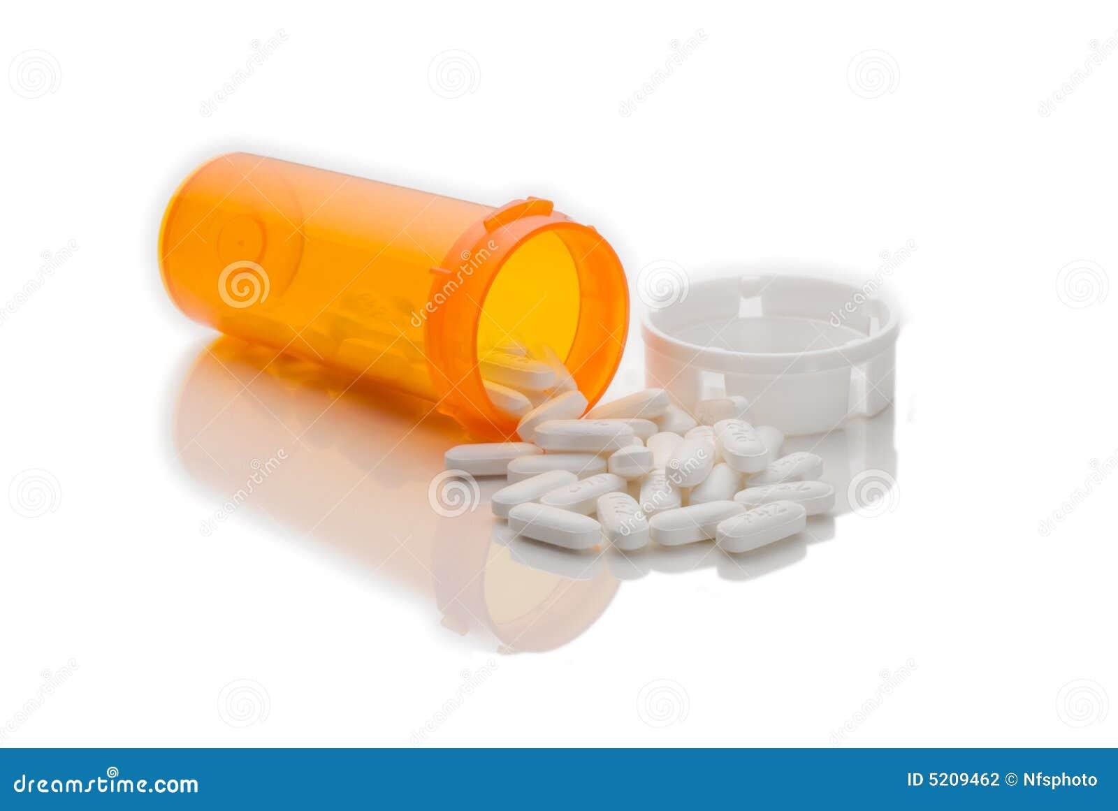 Píldoras derramadas de la botella de la medicación