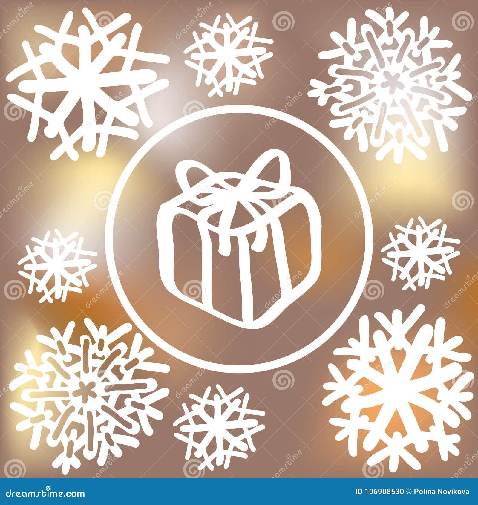Płatki śniegu i prezenta pudełko na zamazanym tle