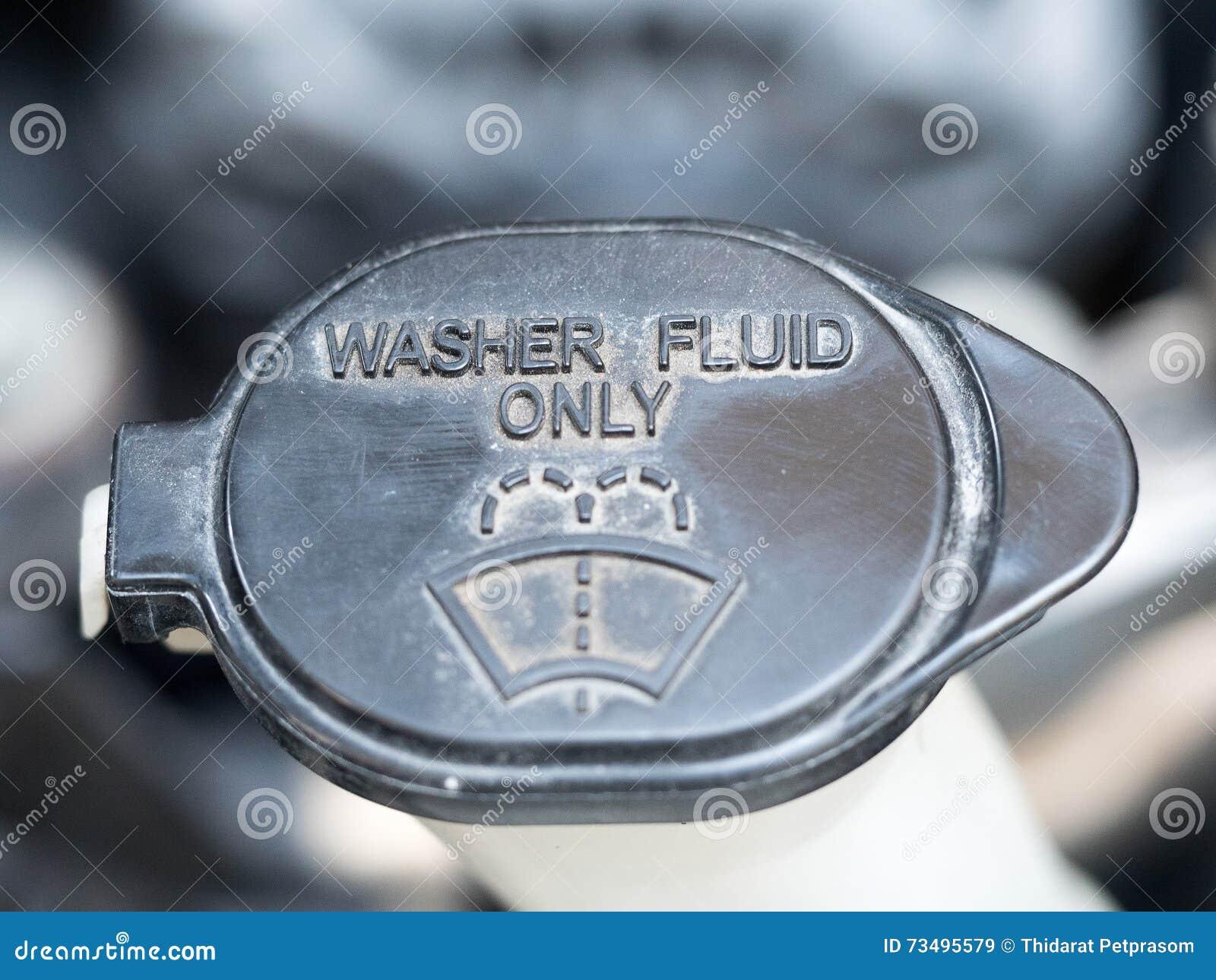 Płuczka fluid Symbol płuczka fluid Zamyka up czarny płuczka fluid wśrodku samochodowego silnika