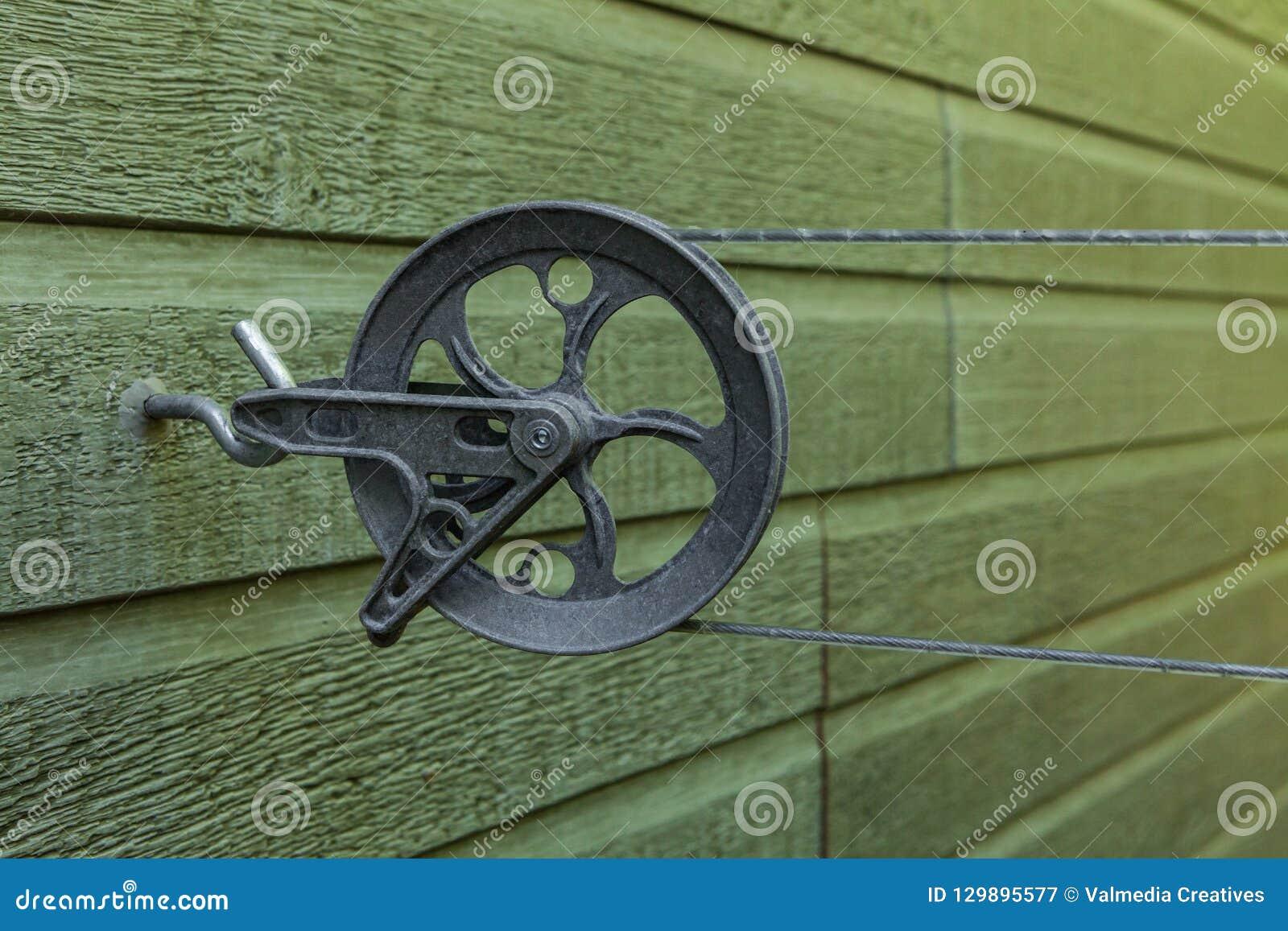 Płuczkowy kreskowy pulley z wspinającą się linią dalej, załatwiający na aluminiowym haczyku